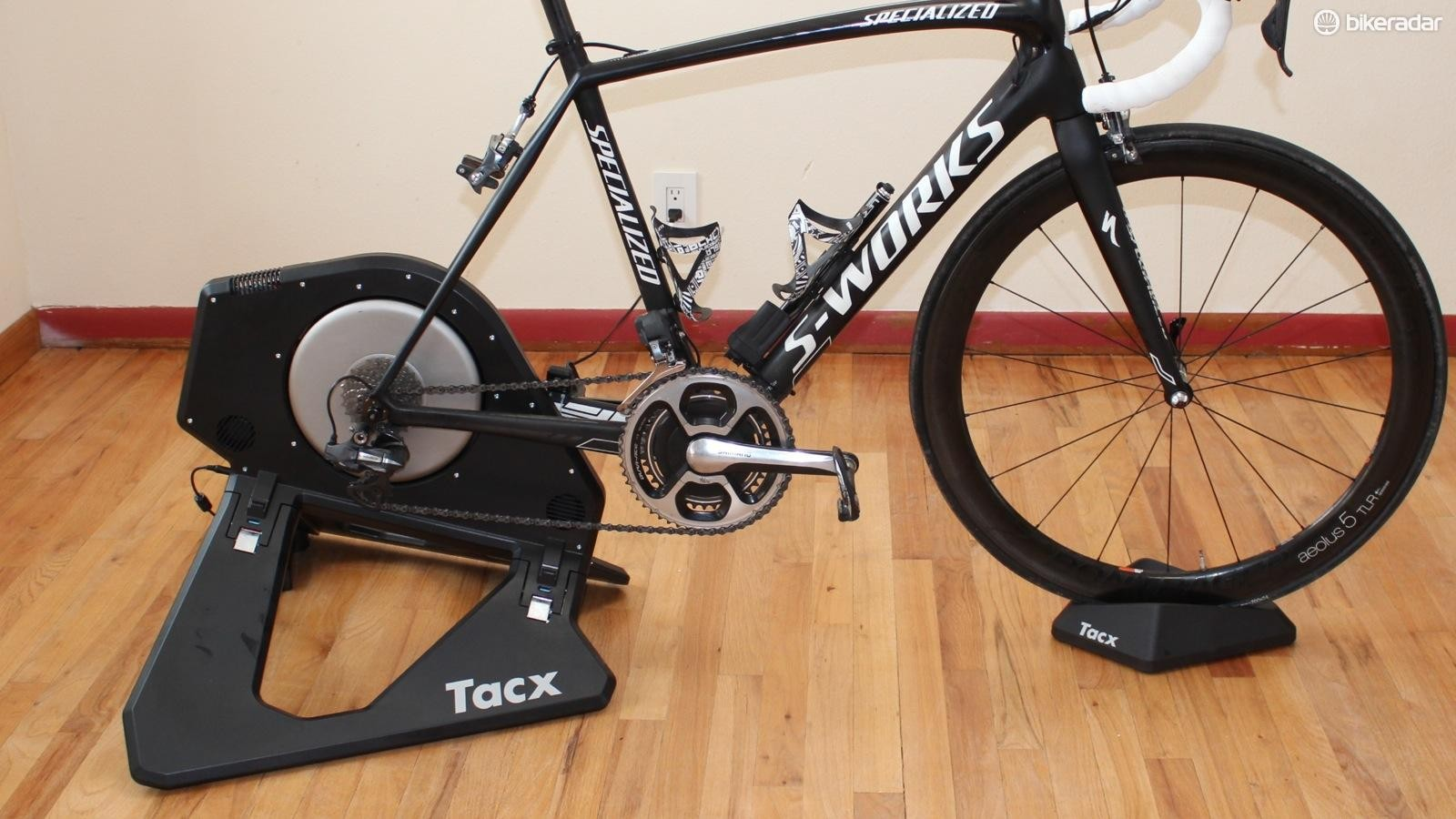 Unlike the Wahoo Kickr, the Tacx Neo Power requires a front wheel riser block