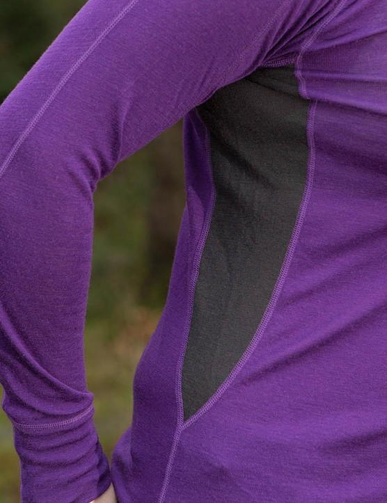 The base layer has a feminine cut and panelled construction