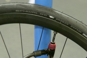A few swift blasts from a decent track pump should seat the tire