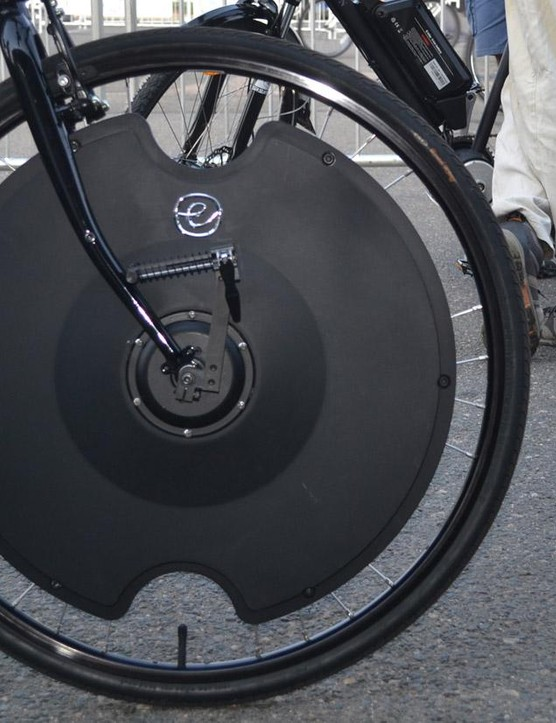 With only a small sensor on the crank, this front wheel motor can help for 30 miles at up to 20mph