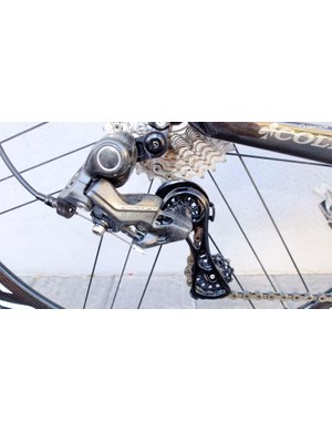 Campy's new 12-speed Record mechanical rear derailleur has a Technopolymer body and alloy cage