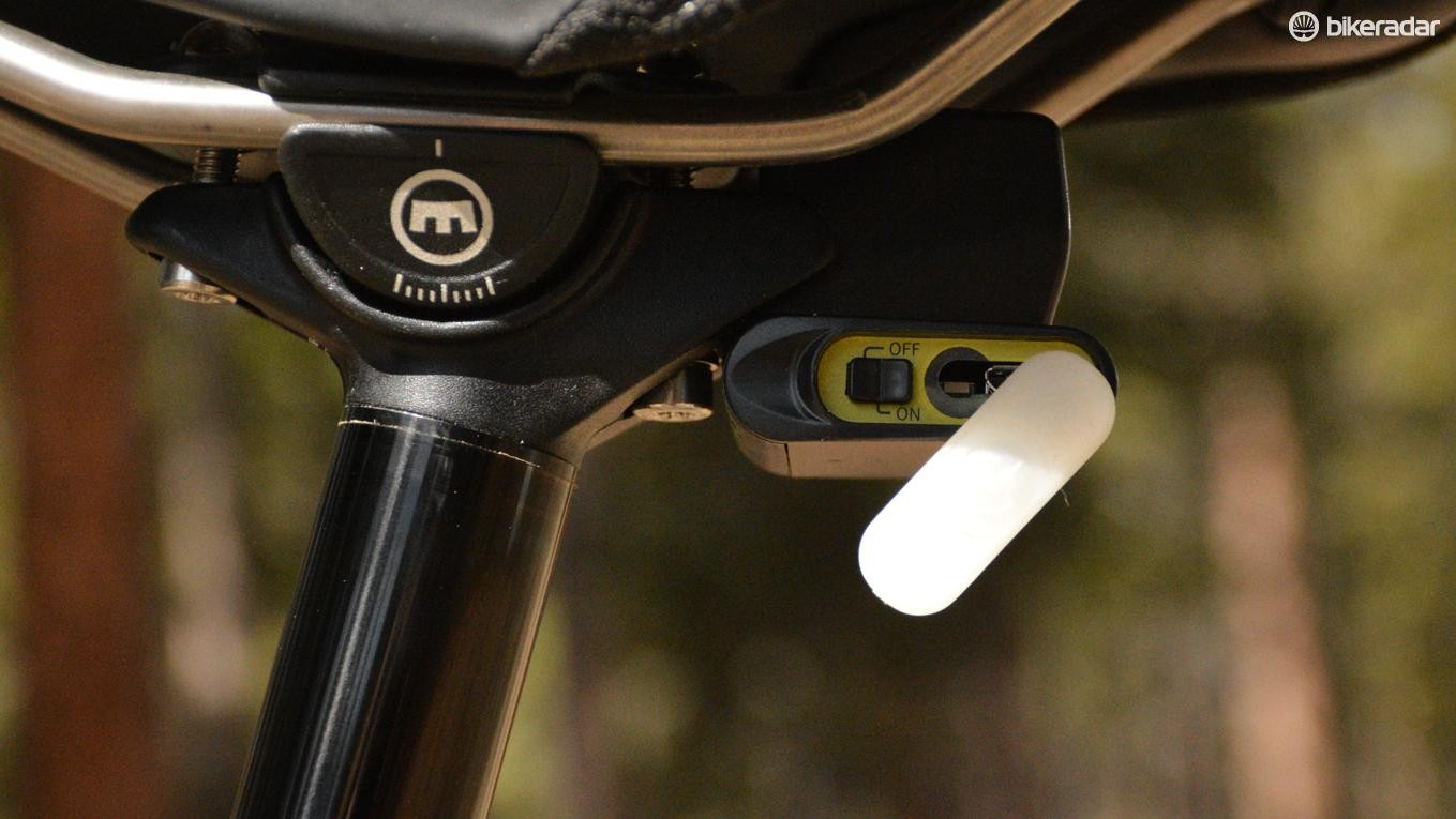 Tucked under the saddle is the charge port, on/off switch and secondary actuation button