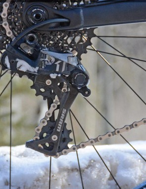 A SRAM X01 rear derailleur snaps through 11 speeds even with a bit of snow clogged in there