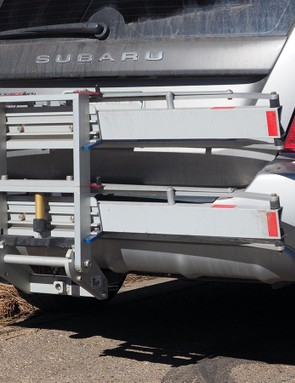 The four-position tilt mechanism allows the rack to folded up tight against the back of the vehicle or tilted down for hatch access when bikes are loaded