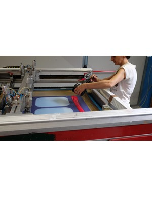 Paint is then applied using a large printing machine