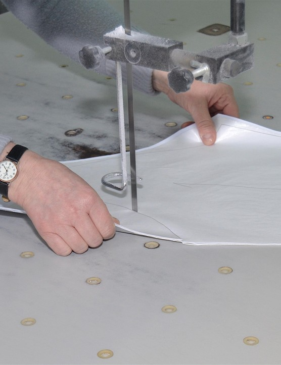 The band saw can cut through many layers of fabric when there are lots of a single sizes to do. The speed and accuracy of the operators is really impressive