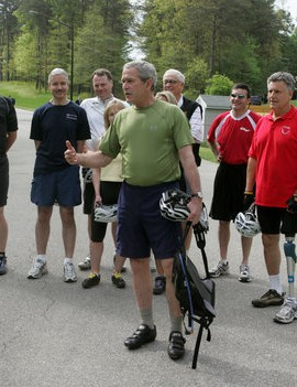Bush takes members of his Council pn Physical Fitness for a ride