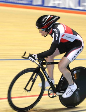 R. White in action as part of the paracycling component to the evening programme