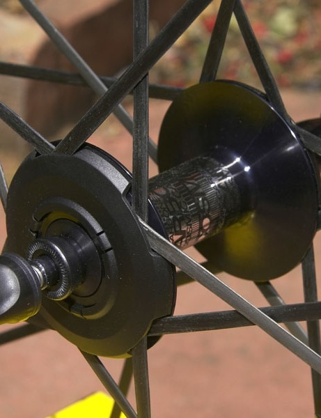 The hubs can be made lighter, too, since the spokes don't really anchor there anymore.