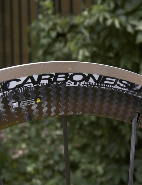 The bonded carbon cap hides a new aluminum rim that is milled in between the spoke holes to shave weight.