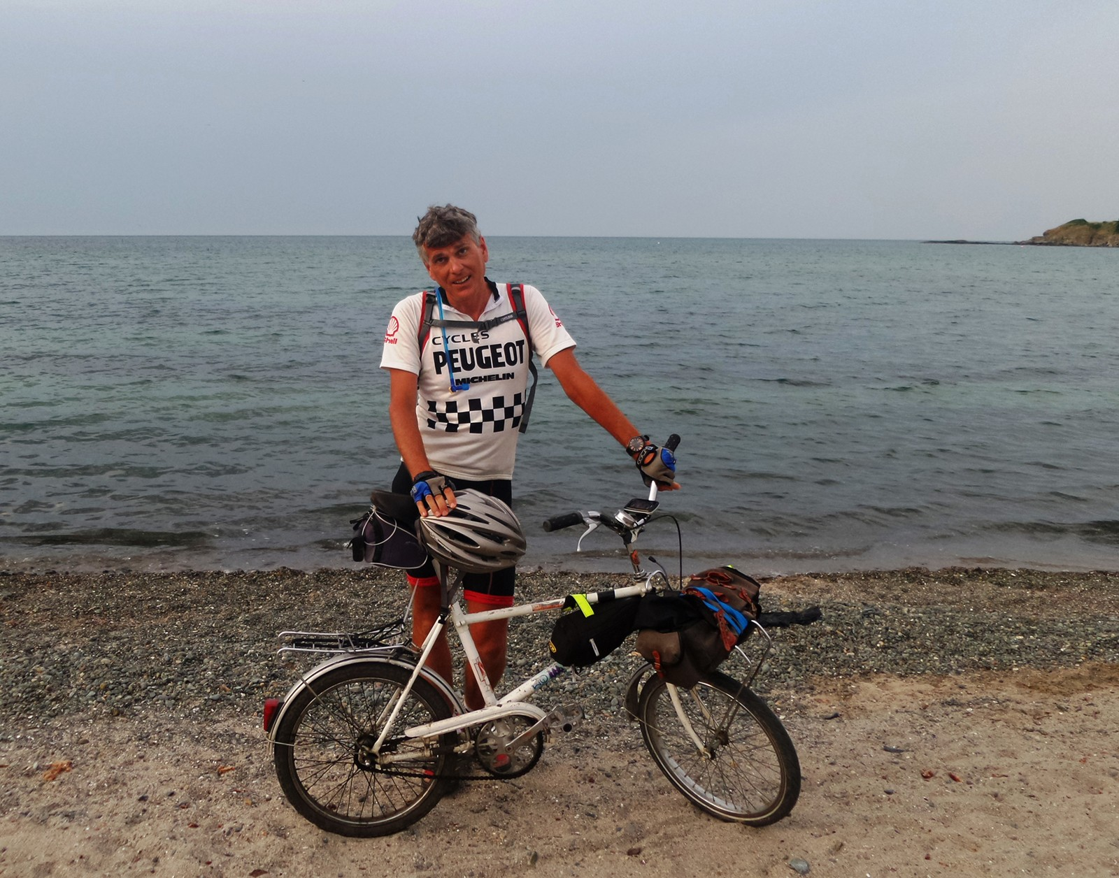Day 87 sees the finish line – sheer relief courses through both his frame, and his bike's