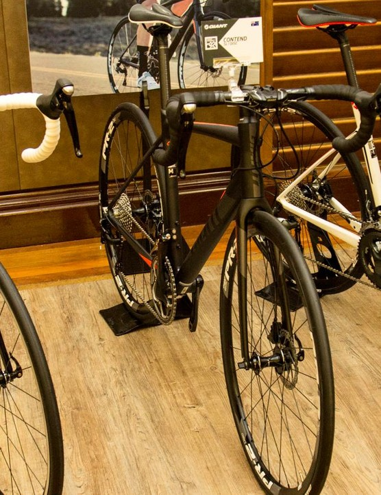 With geometry very similar to the Defy (pictured far right), the Contend is available in both rim and disc brake versions (pictured left))