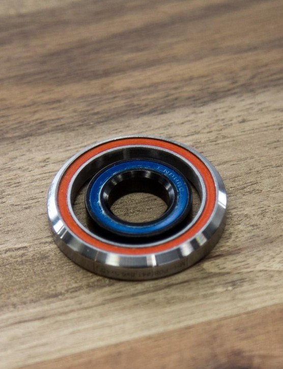 That's one of the Pista Pursuit's headset bearings inside of a stander 1 1/8in headset bearing