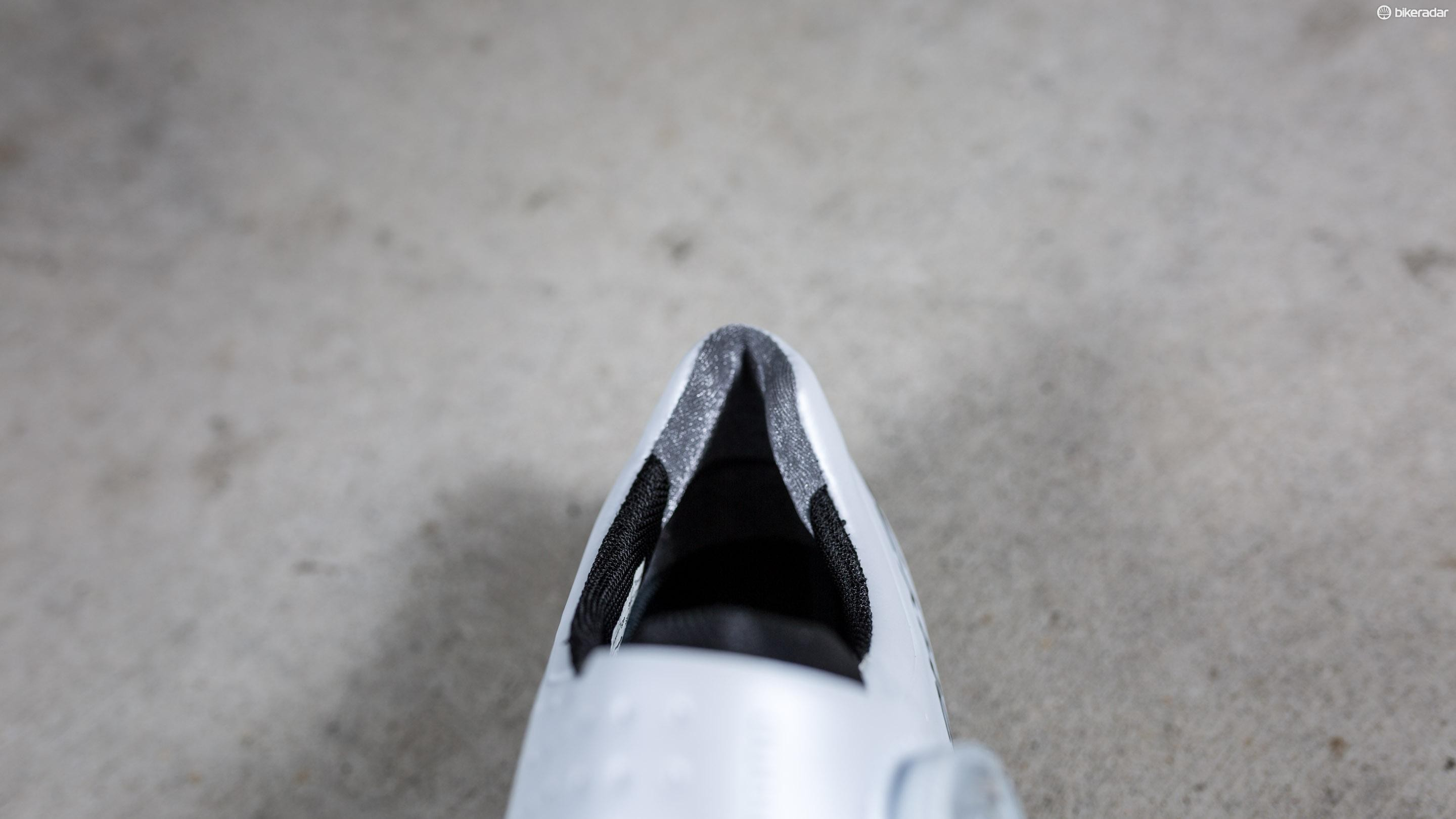 The heel is lined with silver one-way thread, but we still noticed a tiny bit of heel lift