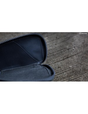 It's lined with soft microfiber and has a couple of internal pockets to keep you organised