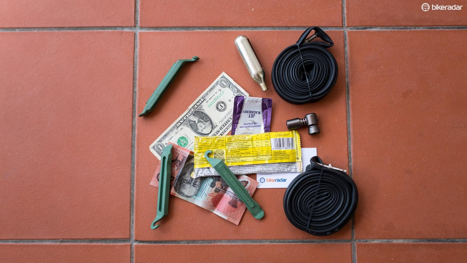 If you find yourself on the side of the road with a big cut in your tires sidewall or casing you can use a wrapper, dollar bill or even a business card to limp home