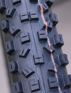 Similar to a motorcycle tire, the tread features a colored band indicating which Addix compound