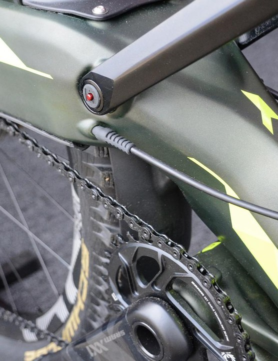 The red button on the upper pivot is an air pressure release valve to keep the ride consistent at all elevations