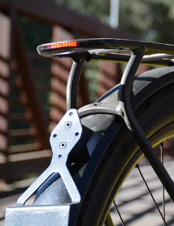 A rack is a necessity for urban e-bikes. One with a taillight is even better