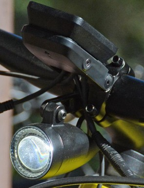 The headlight is bright. It uses an aspherical lens which comes from motorcycle technology