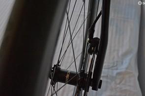 The left fork leg is asymmetric to make room for the flat-mount disc brake