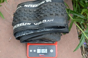 815 grams on my scale with some dirt and tubeless sealant remaining