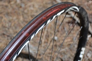 Internal rim width is 25mm. Tubeless compatibility comes from the included tape
