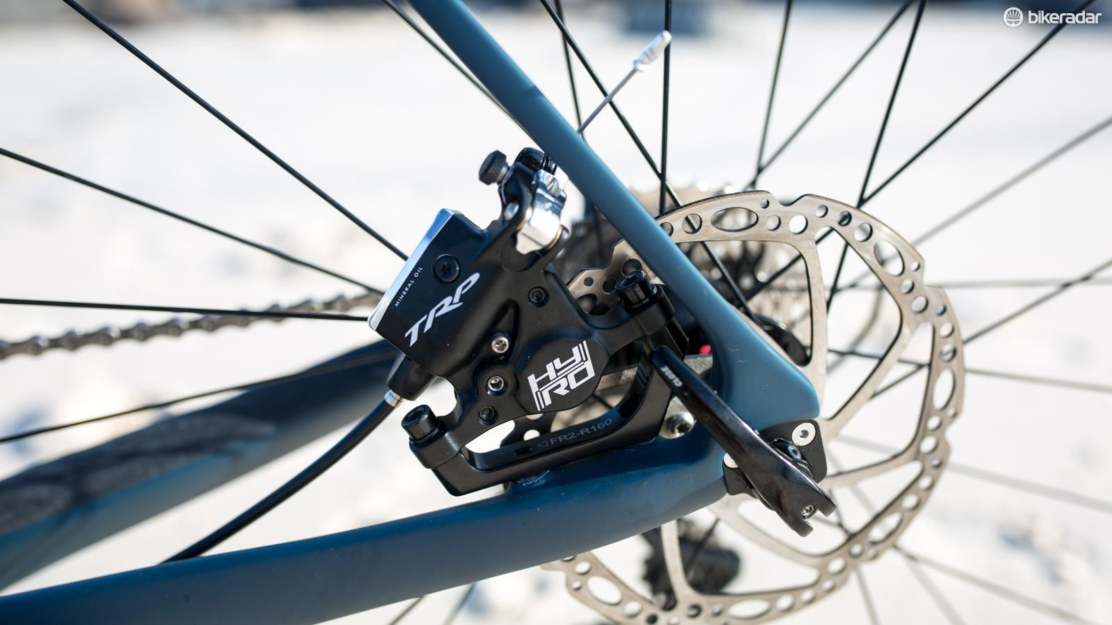 The trouble with the flat mount adaptor is it makes adjusting the rear brake caliper quite difficult