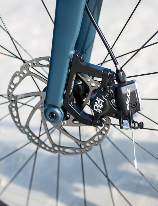 The TRP Hy/Rd Disc cable actuated hydraulic brakes work really well. The trouble is they don't come in a flat mount version, which the frame is designed for, and require an adaptor
