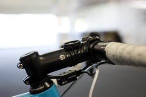 The seat post, handlebars and stem are supplied by Black Inc