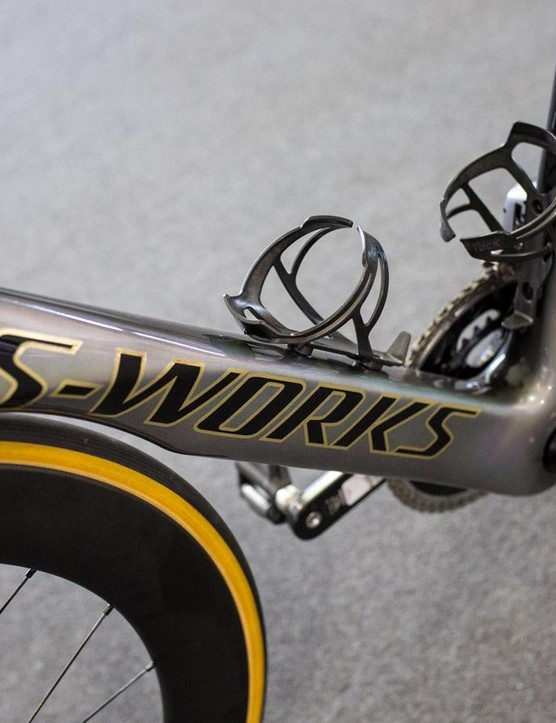 The pearlescent paint and gold lettering represents both the rainbow stripes and gold medal in Doha