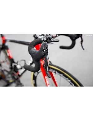 The Super Record EPS shifters feature a carbon brake lever as well as Campy's trademark thumb shifters