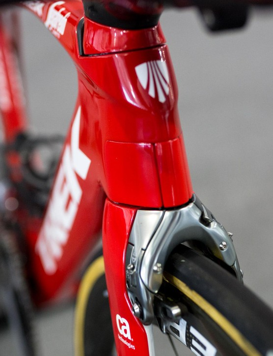 In order to hide the front brake cable, Trek created spring loaded wings that sit at the bottom of the head tube