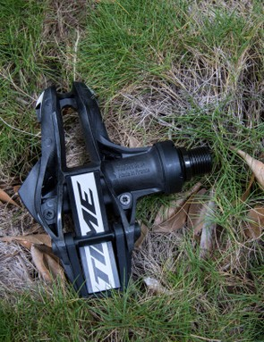 The carbon spring bends to 'pre-open' the clipless system where stepping into the pedal releases a trigger allowing the clasp to snap down on the cleat