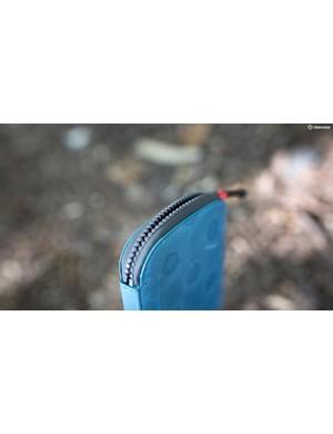 The YKK Aquashield zipper will keep moisture out, but it's not waterproof