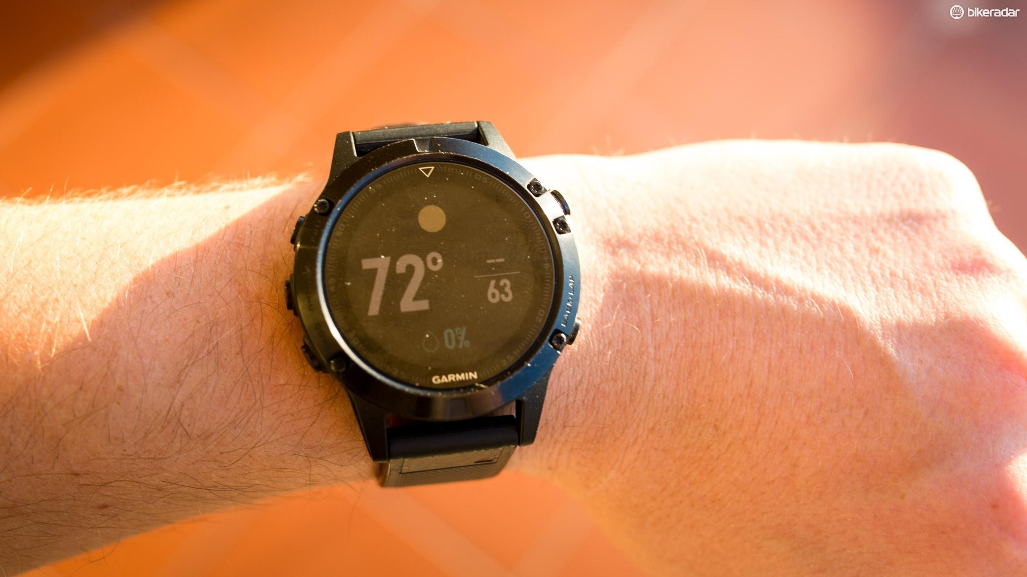 Through a Bluetooth connection to your phone, the fenix 5 can give a weather report
