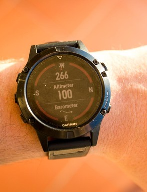 The fenix 5 has a built in compass, barometer and altimeter