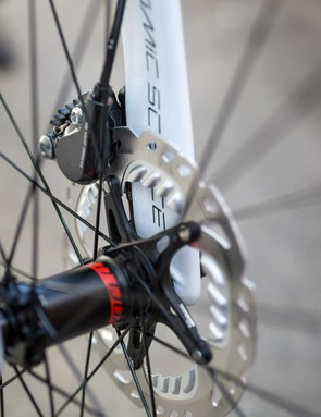 The disc and caliper tuck nicely behind the fork