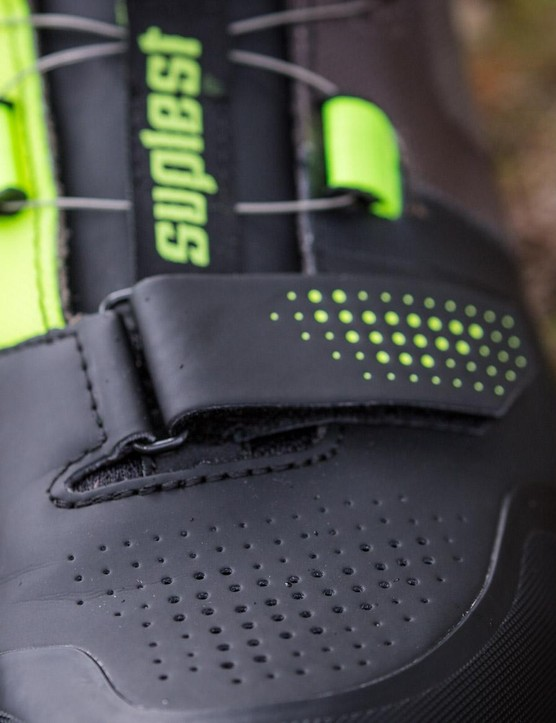 There are perforations over the toe and a Velcro strap to tighten the toe box