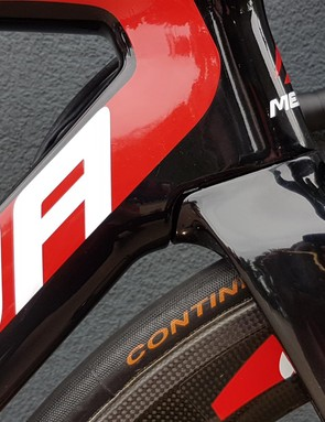 The fork crown cuts into the down tube of the frame