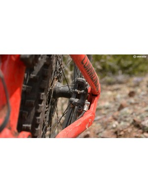 Commencal tucks the rear disc caliper between the stays but it causes the already wide rear end to be even wider