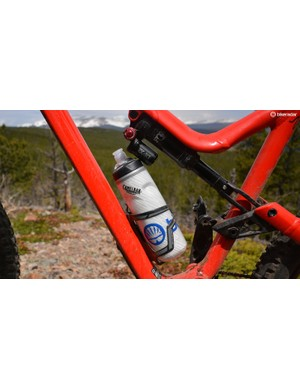 A full-size water bottle fits, just barely. A side-load cage makes bottle entry and exit much easier