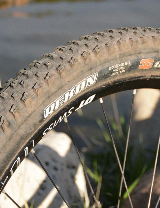 For my rocky, dusty trails, a Maxxis Rekon on the rear worked very well with its fast tread