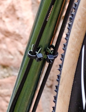 We love the look of these simple, pressed steel cable guides