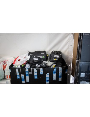 Dimension Data had kit bags laid out for the riders and labelled which cars they'd be going into