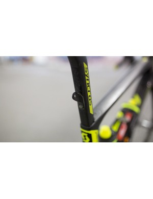 The Mitchelton-Scott mechanics have affixed a mount for each racer's number card