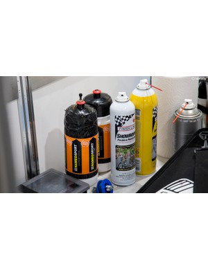 The Trek-Segafredo mechanics use a bidon like a squeeze bottle for tubular glue