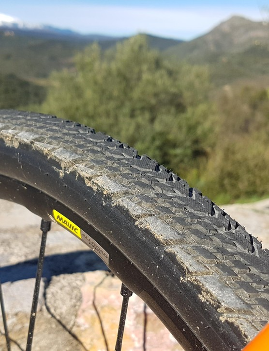 At the back, the chevrons in the tread push water to the side when you're putting the power down