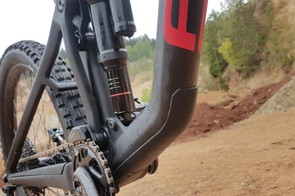 The carbon frame's belly has some plastic protection