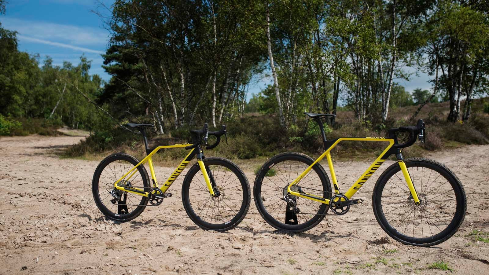 The two smallest frame sizes (3XS and 2XS) of the 8 offered use 650B wheels to offer consistent performance for smaller riders. At right is a 3XL bike